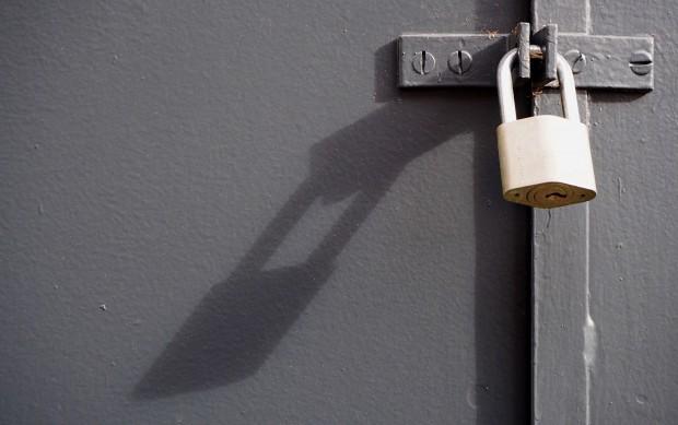 Padlock On Closed Metal Door