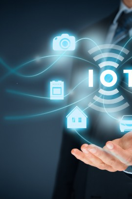 Internet of things (IoT) concept. Businessman offer IoT solution represented by symbol connected with icons of typical IoT – intelligent house, car, camera, watch, washing machine and cooker.